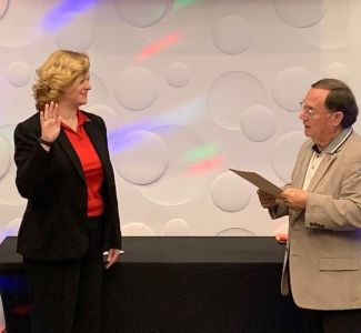President Jennifer Ray being sworn in by Sam Young