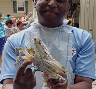 US JCI Senate President Lawrence Pittman with his pet crab at the MD Crab Feed